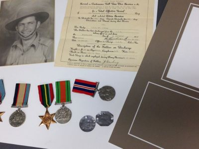 Conservation framing of war medals
